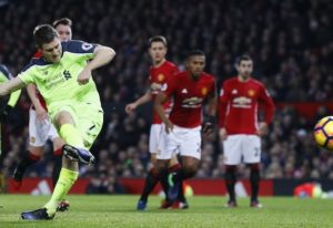 James Milner scores a penalty for Liverpool against Manchester United