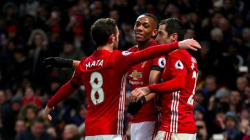Anthony Martial, Henrikh Mkhitaryan and Juan Mata celebrate as Manchester zunited beat Watford 2-0
