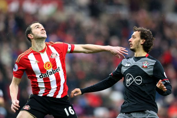 John O'Shea battles for the ball with Manolo Gabbiadini as Sunderland faced Southampton