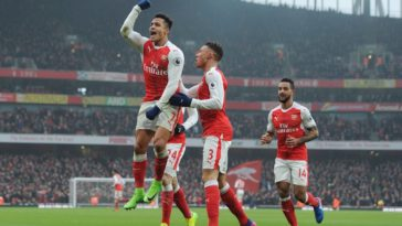 Alexis Sanchez celebrates after bagging a brace against Hull City