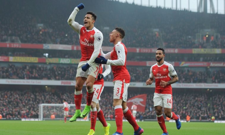 Alexis Sanchez celebrates after bagging a brace against Hull City