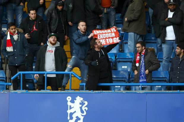 An Arsenal fan demands Wenger quit during a defeat to Chelsea