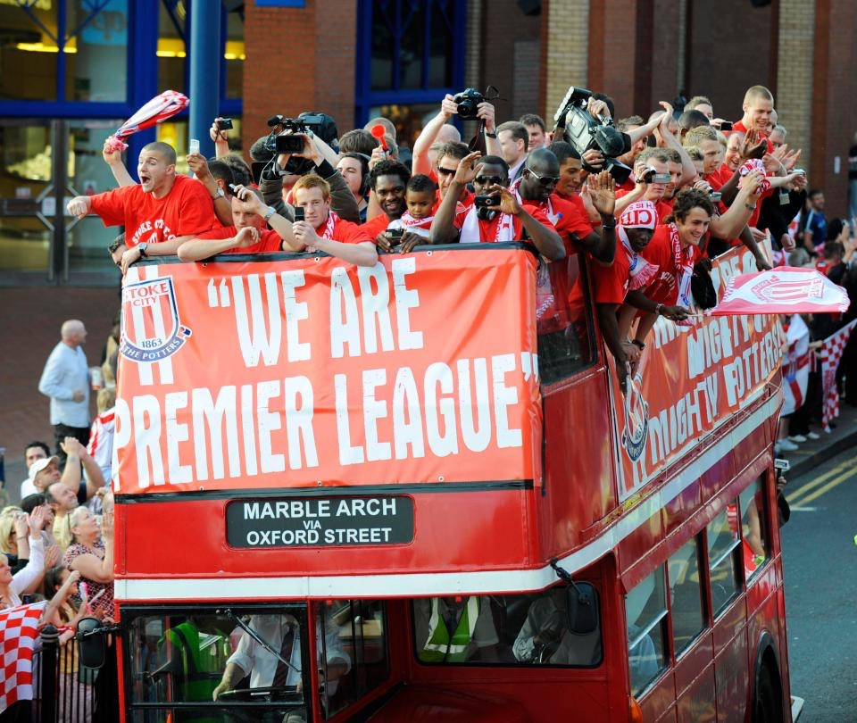 Stoke City celebrate on an open bus through the City after promotion to the Premier League