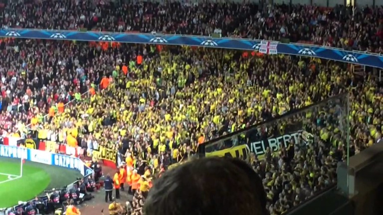 Borussia Dortmund fans recreate the Yellow Wall at the Emirates against Arsenal