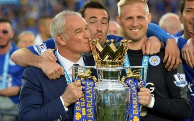 Claudio Ranieri and Kasper Schmeichel celebrate winning the Premier League with Leicester City