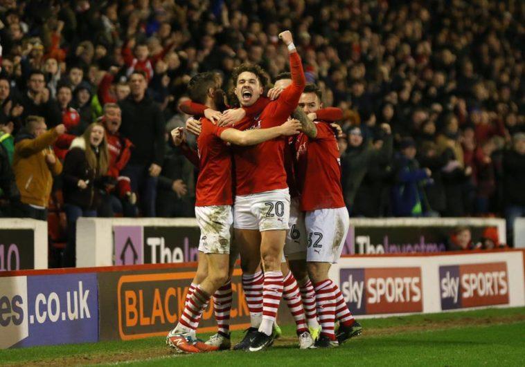 Tom Bradshaw celebrates scoring for Barnsley against Leeds United