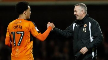 Helder Costa celebrates with Paul Lambert as Wolves get a late winner against Brentford