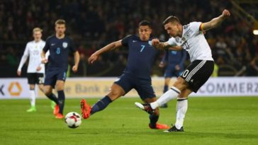 Lucas Podolski fires Germany ahead in a friendly match against England in Dortmund