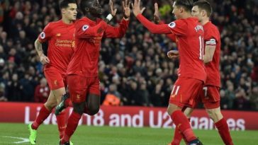 Sadio Mane celebrates scoring a goal for Liverpool against Arsenal with Roberto Firmino