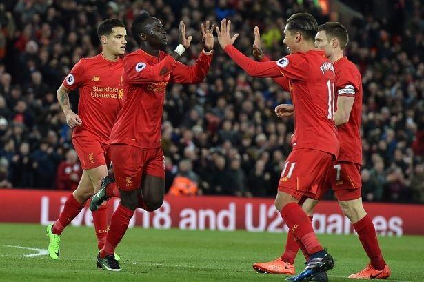 Sadio Mane celebrates scoring a goal for Liverpool against Arsenal with Roberto Firmino