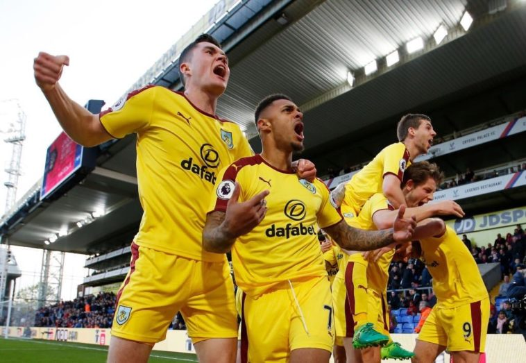 Andre Gray celebrates after scoring for Burnley