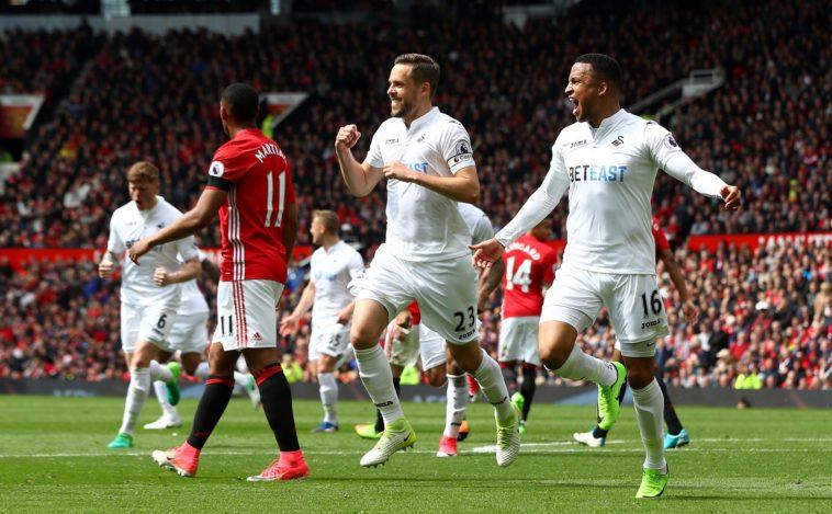 Gylfi Sigurdsson celebrates after his stunning free kick against Man Utd