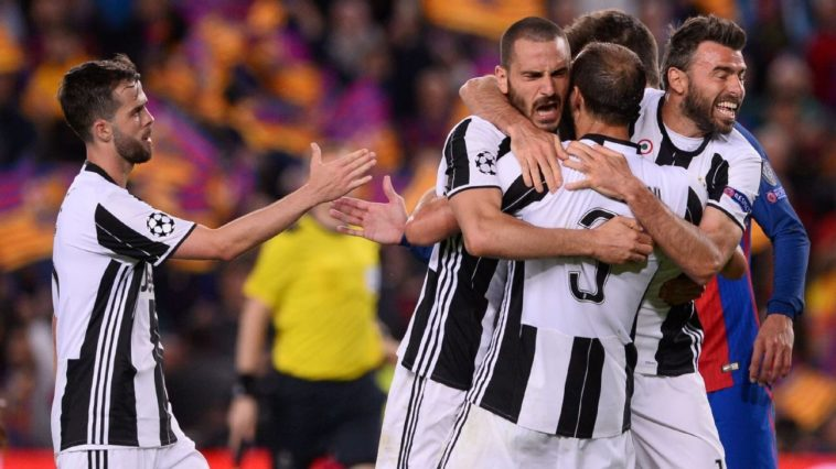 Juventus celebrate after beating Barcelona on aggregate to progress to the Champions League semi finals