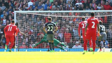 Fraser Forster saves a penalty from James Milner