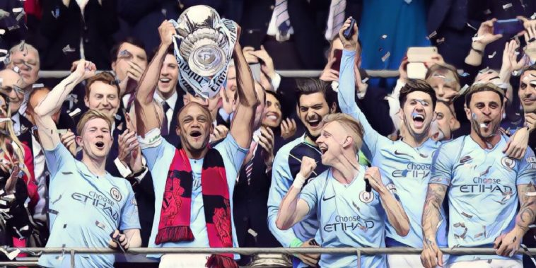 Vincent Kompany lifts the FA Cup high as Man City beat Waford 6-0
