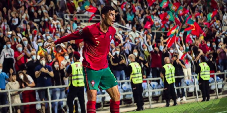 cristiano ronaldo celebrates after netting his 10th hat trick for portugal